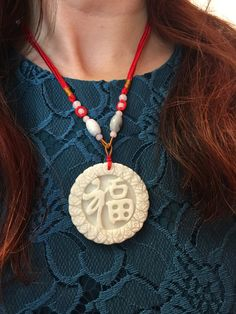 Invite wealth and good fortune by wearing this Feng Shui jade pendant necklace Fu close to your heart.