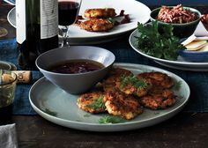 Smoked Fish Fritters With Beet Vinaigrette Smoked and fresh fish join forces in this much-appreciated update to the often-maligned gefilte fish. To get the job done faster, use two skillets. Passover Recipes, Jewish Recipes, Smoked Fish, Zucchini Fritters, Beets, Seafood Recipes, Seafood Dishes, Bon Appetit, Vinaigrette Recipe
