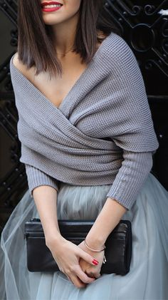 Grey wrap sweater, grey tulle skirt, black clutch, red lipstick and red nails.