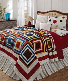 Kaleidoscope Patchwork Quilt Bedding Collection Love the use of plain fabrics here, very striking, simple pattern