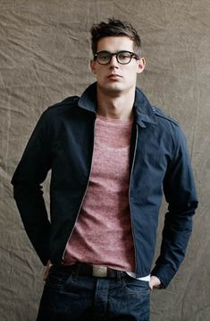 Todd Snyder navy jacket, shear red crew neck shirt, white tank top, black belt, dark blue jeans, dark frames