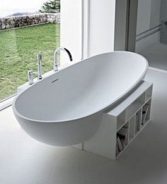 A surprisingly elegant bathtub from Rexa Designs seems to delicately balance on a small bookcase platform. The egg-shaped tub offers a gently curved space in which to wash away the worries of the day, while the integrated shelves give you the perfect place to store shampoos, bubbles, incense and your favorite books.