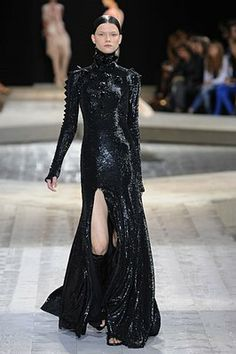 Givenchy Fall 2009-- this dress looks like its made of liquid. Check out the scales on the arms!
