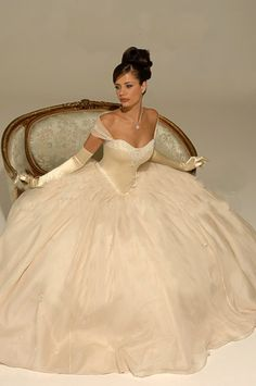 love the ball gown style but the skirt is a bit too full, love the V-hem between bodice and skirt