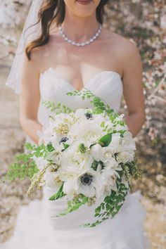 Anemones give an all-white bouquet a little pop! Photography: Anna Delores Photography - www.annadelores.com  Read More: http://www.stylemepretty.com/2014/08/20/elegant-modern-california-ranch-wedding/