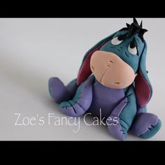 There is a free Eeyore tutorial available on my YouTube channel; Zoe's Fancy Cakes #eeyore #winniethepooh #donkey #cartoon #cake #cakes #caketopper #caketoppers #zoesfancycakes #handmade #youtube #youtuber #youtubetutorial #tutorial #free #art #cute #birthdaycake #fondant #icing