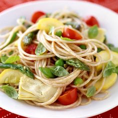 This pasta dish is full of fresh, spring vegetables. Use small, whole basil leaves or pile up some bigger ones and slice them into thin pieces. #recipe #WWLoves 7 SmartPoints