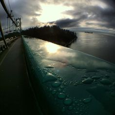 Rain drops on the handrail of the Lions Gate Bridge in Vancouver Canada. Tourists often come here to watch the sunset and view cruise ships departing for Alaska. Lions Gate, Rain Drops, Alaska, Vancouver, Cruise, Bridge, Canada, Sunset, Outdoor