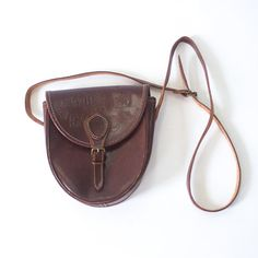 vintage brown leather buckle front cross body purse with a fun tribal twist