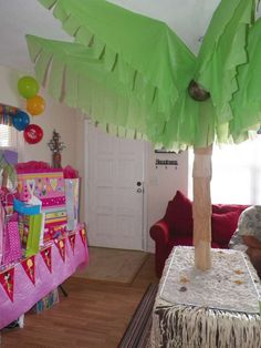 could do this with green plastic cloth from $2 shop - don't think could get tissue/crepe paper big enough     Luau Birthday Party Ideas | Photo 7 of 8