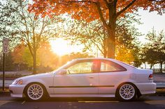 Joseph's Honda Civic EJ8 Coupe by TJ Chao on Flickr - Those classic Enkei NT-03 wheels make for some white on white deliciousness