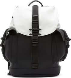 ca6035839fb0 Matte buffed calf leather backpack in black. Contrast colorblock foldover  flap at bag top in white leather. Structured patch pockets and grosgrain ...