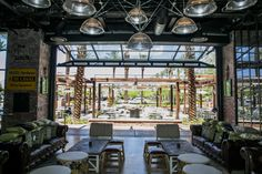 The inclusion of our SST-II Glass Bifold Door within the Hearthstone design creates an expansive entry, drawing customers from the adjacent walk into the rustic dining area. Nomad Hotel, Cellar, Dining Area, Las Vegas, Barn, Crown, Doors, Rustic, Drawing