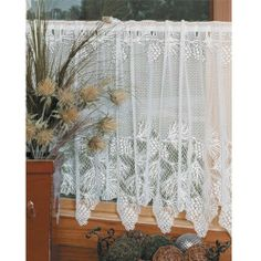 """24"""" Woodland Lace Tier Curtain - White by Heritage Lace. $20.99. 60"""" wide x 24"""" long. Do you want to add a delicate lace accent to your windows without drawing too much attention away from the room's original decor? The Woodland Lace Curtain Panel and Valance by Heritage Lace is a great choice for adding a simple touch of luxury to a kitchen, bedroom, dining room and more. The lace comes in ecru and white with a woodland pine motif to set a mood of nature appreciation and..."""
