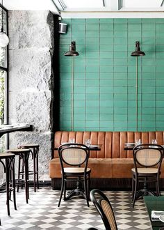 les trois cochons // the colors are gorgeous. Green tiled wall, brown leather banquette, and black chairs