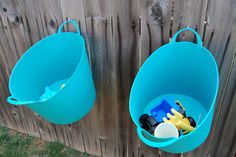 I like this idea. You could put some drain holes in the bins too. We don't have fence space, but it would be great to have kids toys bundled to go out to the big common area of the co-op    Backyard Toy Storage. Hang containers right on the fence, low enough so kids can put their toys away & they can be moved to any part of the yard or taken to the beach