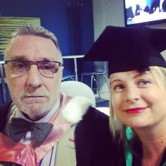 Kardi Somerfield @kardisom  ·  Jul 15  All gowned up with @sportmarketing1 (who has a serious face especially for this important day) #GradsUN14