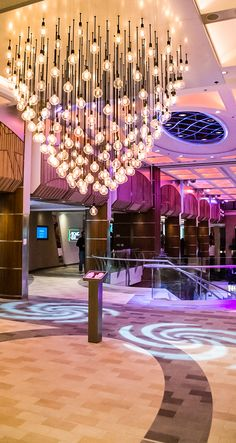 Interact with the art onboard Anthem of the Seas. This heartbeat chandelier will flicker with the beat of your pulse.