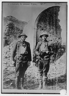 Two US soldiers pose with a trophy Long Luger pistol somewhere on the Western Front, WW1. The Luger was already famous as a robust, technically advanced handgun. Its complicated design, however, never allowed its truly mass production. Luger production continued up until the beginning of WW2. By then, the Luger had achieved enough fame to become a hotly pursued trophy by Allied soldiers.
