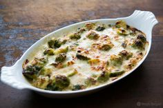 Brussels sprouts blanched and baked in a cheesy white sauce with pancetta and gruyere. A perfect Thanksgiving side!