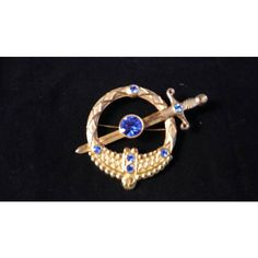 Now On Sale Blue Sword Rhinestone Pin, Vintage Brooch, Mid Century... ($23) ❤ liked on Polyvore featuring jewelry, brooches, rhinestone jewelry, vintage brooches, pin brooch, vintage pins brooches and blue brooch