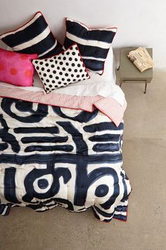 paola navone for anthropologie - I just love this bold use of graphic prints and a shot of vibrant pink...YUM!!