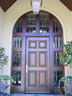 """Estate Exterior Wood Front Entry Door Style DbyD-1019.   This Front Exterior Entry shows a Mahogany 42"""" X 96"""" Standard 6 Panel Door with two Custom TDL with Leaded, Beveled Glass Sidelites and a Custom 4 piece TDL with Leaded, Beveled Glass Transom.  It is stained in Traditional Mahogany.  The hardware shown is Period Brass."""