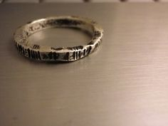ogham ring where the writing follows the edge, like in real ogham stones!