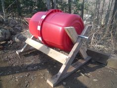 My homemade compost bin from two buckets, 2x4s, and some hardware store parts.Click To Enlarge