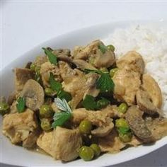 Keon's Slow Cooker Curry Chicken | Chunks of chicken breast cook slowly in a creamy, curry-flavored sauce with coconut milk, peas, and mushrooms for a nicely spicy take on a slow cooker chicken dish. Serve over rice or with hot naan bread.