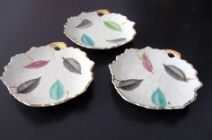 Set of three leaf-shaped vintage dishes for rings and trinkets! With gold trim and feather-like leaves in grey, mint, green, & pink purple