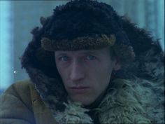 """Artur Barcis appears in the majority of Krzystof Kieslowski's """"The Decalogue"""" in a silent role. Is he a figure of divine judgement on the characters in the films? Or is he merely a figure who provides 'the look' which provides moral meaning to the actions being performed?"""
