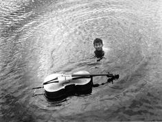 Maurice Baquet and his cello, ca 1950 -by Robert Doisneau OMG his cello is in the water! Robert Doisneau, Henri Cartier Bresson, French Photographers, Street Photographers, Maurice Baquet, Musée Rodin, French Street, Paris Street, Paris Paris