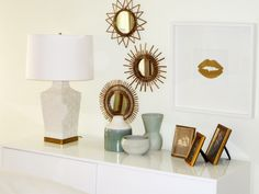 Gold and white console table styling. Lip print by Jennifer Latimer of Gilded Mint. The Dale's Digs : Bedroom
