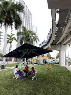 Kudos to the City of Miami and some forward-thinking residents and stakeholders for converting a pedestrian-unfriendly median/parking lot in downtown Miami into a temporary park. Don't blink or you'll miss it; the park will only be intact for five days (thru Sunday). But its very existence is sparking some very healthy discourse about how we use public spaces and how we can further evolve Miami into a more livable, walkable, sustainable city.