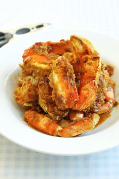 Chili Crab - Had my first taste of this at Fatty Crab in NYC. Found a great recipe on RasaMalaysia. I've made it a couple times and my family LOVES it. try it here: http://rasamalaysia.com/recipe-chili-crab/2/