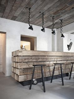The lights and stools give this room a very Industrial Feel