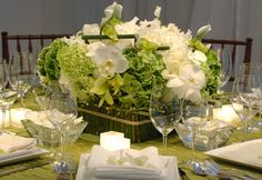 Orchids and Green Hydrangea wrapped in Bamboo- Preston Bailey Event Design