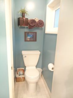 """Paint the master bath water closet a fun color to brighten it up Paint color for bathroom Valspar """"Summer House Blue"""". Not sure why every one puts towels on display in a room with just a toilet. Room Paint Colors, Small Toilet Room, Small Toilet, Bathroom Colors, Toilet, Painting Bathroom, Downstairs Bathroom, Bathroom Design, Room Paint"""
