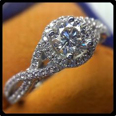 This is the closest I have found to my engagement ring. Diamond halo and the twist styled band are masterfully combined in the Wedding Engagement, Wedding Bands, Engagement Rings, Dream Wedding, Wedding Day, Wedding Stuff, Wedding 2017, Wedding Dreams, Infinity Band