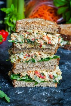 Garden Veggie Chickpea Salad Sandwich -15oz can chickpeas, rinse; 3 scallions, chop; 2 stk celery, chop; 1/4c: shredded carrot, fine chop red bell, fine chop dill pickle & mayo; 1-2t dijon; 1t yellow mustard; 1/8t: dill, salt & pepper; 3T unsalted roasted sunflower seeds; 2T chopped basil -Mash beans to tuna salad. Add all ingredients. Use alone or on bread, wrap or crackers. Serves 2-4 Can make-ahead 4<days
