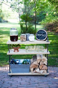 Firepit Patio - Country Cottage DIY Circular Outdoor Entertaining Space Lumber and pipes were used to make this s'mores fixings cart from Brooklyn Limestone. Positioned on wheels, the BBQ cart works as a firewood caddy or outdoor bar cart as needed. Outdoor Bar Cart, Diy Outdoor Bar, Outdoor Kitchen Bars, Outdoor Kitchen Design, Outdoor Decor, Outdoor Living, Party Outdoor, Patio Party Decor, Outdoor Serving Cart