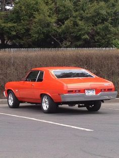 Vintage Orange color Chevy Nova 60s appreciated by Motorheads Performance www.musclecarssanantonio.com