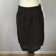 "Ann Taylor Loft Skirt- Sz 6 Beautiful charcoal grey skirt with ribbed elasticized waistband & back zipper. The fabrytag has been removed, but it feels like a linen overlay with polyylining. Waist- 16"".  Length- 21"". Ann Taylor Loft Skirts"