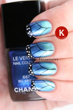 Pinned by www.SimpleNailArtTips.com Butterfly nails created using a gradient of Chanel Azuré and Bel-Argus; then stamped using Nailz Craze plate NC01 and W7 Black