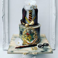 Harry Potter Cake maybe not the top part, but the bottom sure is cool. You could have four other tiers with the house crests on them.