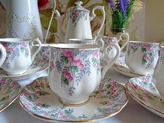Very pretty vintage 1940s Royal Albert bone china coffee set in the Rosedrop pattern of dainty handpainted pink roses and gold trim. The set