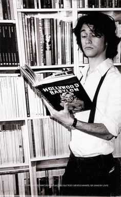 'This book is slightly...weird.'  His expression cracks me up!
