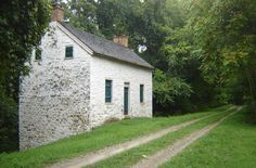 C&O Canal National Parks Service - Plan Your Visit A lockhouse situated next to the towpath surrounded by trees.