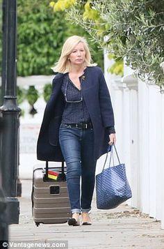 The Duchess of Cambridge's stylist, Amanda Cook Tucker, was seen wheeling a suitcase into ...